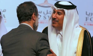 Qatari prime minister Sheikh Hamad bin Jassem al-Thani )congratulates Ahmed Moaz al-Khatib,, after he was elected head of the new Syrian Opposition bloc in Doha.