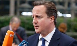 British Prime Minister David Cameron speaks with the media as he arrives for an EU summit in Brussels on Friday, Nov. 23, 2012.