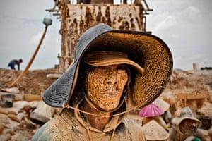 Tin Mining: Portrait of a tin miner at a PT Timah tin ore mine in Tanjung Pesona