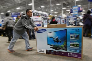 Black Friday: San Francisco, California: A man pushes a flat-screen television