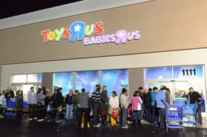 Black Friday: Schaumburg, Illinois: Shoppers line up outside a Toys R Us store