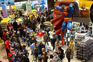 Black Friday: New York: Shoppers wait to pay in the Times Square Toys-R-Us store