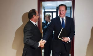 French President Francois Hollande (L) shakes hands with British Prime Minister David Cameron after a meeting at the EU council headquarters in Brussels