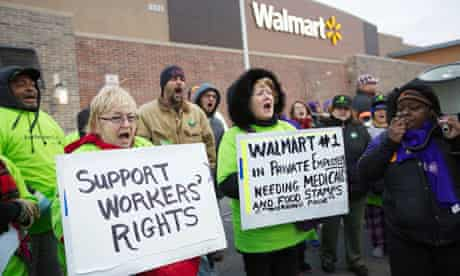 Protesters demonstrate outside a Walmart store in Chicago on Black Friday