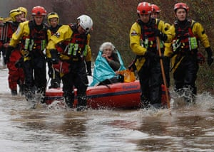 Autumn weather: Diana Mallows, 90, is rescued from her home