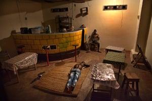 FTA: Joe Penney: A man sleeps on the floor of a bar, Bolama