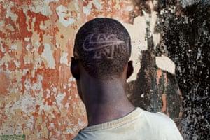 FTA: Joe Penney: Student Samba shows a Nike logo shaved into his hair