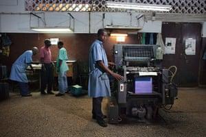 FTA: Joe Penney: Men work at Guinea-Bissau's main printing press, INACEP
