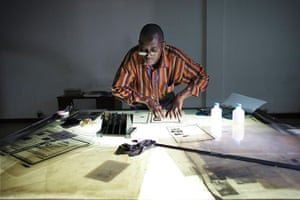 FTA: Joe Penney: A man works putting together Guinea-Bissau's state newspaper