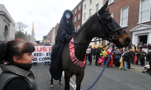 "A protestor rides on a horse draped in a sash bearing the slogan ""No To Austerity"" at the head of a march against Government austerity measures in Dublin, Ireland"