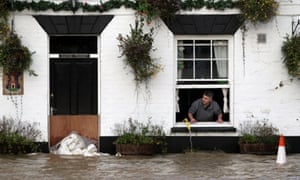 David Boazman, landlord of the White Bear Pub in Tewkesbury looks out of the window at the flood water as he tried to pump some water from the building.