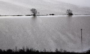 Flooding in Glastonbury in an image that looks more like a painting than a photograph.