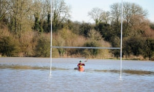Tim New makes use of the flooded Rugby pitch in Rugby, Warwickshire. There are more than 200 flood warnings in place across the country.
