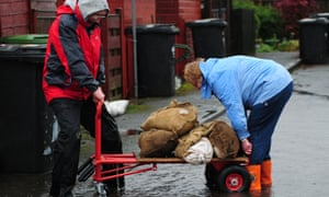The bad weather is heading northwards so residents in Catterick, North Yorkshire prepare to defend their homes with sandbags.