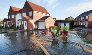 The residents of Worle in Somerset after suffering after flash floods overnight. Firefighters install water pumps to try save houses from floodwaters.
