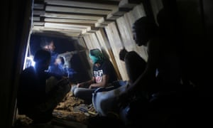 Palestinians repair a smuggling tunnel dug beneath the Egyptian-Gaza border in Rafah, in the southern Gaza Strip.