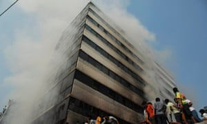 Fire fighters try to control a fire in Dhaka as smoke engulfs another 11-storey garment factory building in the suburb of Uttara. This time there were no reports of deaths, but eight workers were injured due to heavy smoke. The scene drawn a large crowd.