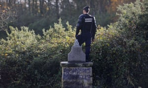 Looking like a statue  a French riot police officer guards an area where protesters are squatting on protected swampland near Notre-Dames-des-Landes not far from the French western city of Nantes, where the prime minister wants to build a new airport.