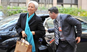 International Monetary Fund (IMF) Managing Director Christine Lagarde (L) arrives on November 26, 2012 prior to an Eurozone meeting at the EU Headquarters in Brussels.