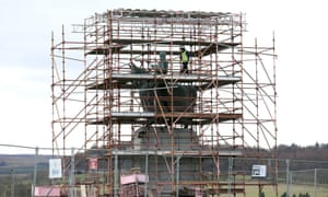 Historic Scotland apprentice stone mason Liam Grubb on the scaffolding as restoration work begins on the weather-beaten statue of Robert the Bruce at the Battle of Bannockburn site, to restore the statue ahead of the 700th anniversary of the battle.
