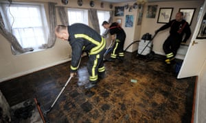Firefighters from Wiltshire fire service use an Aquavac to help clear homes in Malmesbury after they were flooded over the weekend.