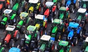 Farmers stand among hundreds of tractors during a demonstration by european milk producers in central Brussels. Thousands of dairy farmers from all over Europe took part in the demonstration to urge politicians to take efficient legislative measures for the milk market and to listen to farmers' demands for cost-covering prices and fair remuneration, according to the organisers.