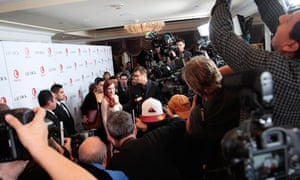 Photographers take pictures of actress Lindsay Lohan