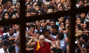 The Dalai Lama greets students as he leaves the Christ University campus in Bangalore, India after delivering his lecture on 'Science and Religion.