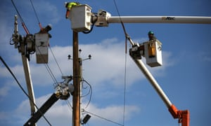 Utility workers replace a pole that was damaged by Superstorm Sandy in Seaside Heights, New Jersey.  New Jersey Govenor Christie estimated that Superstorm Sandy cost New Jersey $29.4 billion in damage and economic losses.
