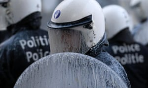 Riot police are at the receiving end as european milk farmers dump milk on the European Parliament during a demonstration in Brussels.