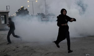 Bahraini anti-government protesters run from tear gas fired by riot police in Manama, Bahrain. Riot police in Bahrain have fired tear gas and stun grenades to disperse marchers.