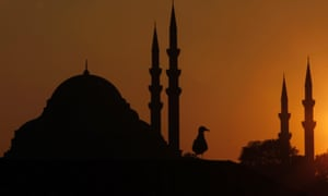 The sun sets over the Ottoman-era Suleymaniye Mosque in Istanbul.