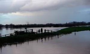 People walk across flooded fields near North Curry, Somerset.