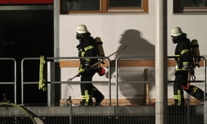 Firemen go into a Caritas employment facility for the handicapped in which 14 people died in a fire in Titisee-Neustadt, Germany. The fire was reportedly caused by an explosion at the facility, where approximately 120 people with disabilities are employed in light manufacturing.