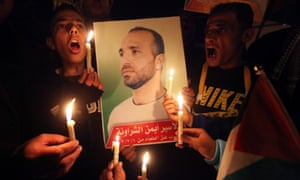 Relatives of Palestinian Ayman al Sharawleh call for his release in Dwora village near the West Bank city of Hebron. Al Sharawleh who is jailed in Israel has been on a hunger strike for 150 days. Photograph: Abed Al Hashlamoun/EPA
