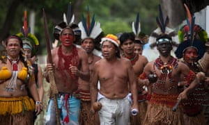 Native unrest: Indigenous people from various tribes protest outside the Maracana stadium as sports officials visit the stadium in Rio de Janeiro, Brazil. Indigenous leaders are fighting the destruction of the old Indian Museum set to be demolished as part of renovation on the Maracana stadium that will host the World Cup soccer tournament in 2014.