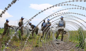 The UN wiring: The South Africa's contingent of the U.N. peacekeepers in Congo erect a razor wire barrier around Goma airport in the Democratic Republic of Congo.