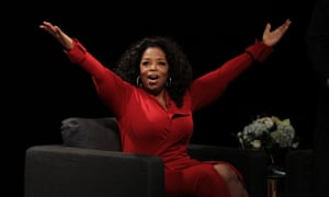 """Oprah Winfrey acknowledges the audience after she came to the stage for an interview with Ball  State University alumnus David Letterman, host of CBS's """"Late Show,"""" at Ball State University in Muncie, Indiana."""