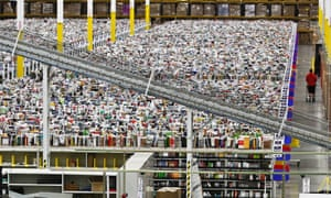 An employee walks a wide isle at Amazon.com's 1.2 million square foot fulfillment center in Phoenix. Americans clicked away on their computers and smartphones for deals on Cyber Monday, which is expected to be the biggest online shopping day in history.
