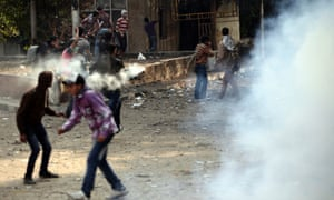 Egyptians clash with security forces and attempt to throw back tear gas canisters fired at them near Cairo's Tahrir square, where an opposition rally has been called for to voice rejection of President Morsi's seizure of sweeping new powers. The Health Ministry said 444 people have been wounded nationwide.