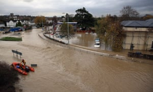 An RNLI life boat crew work in the flooded streets of St Asaph in north Wales after torrential overnight rain on 27 November 2012.