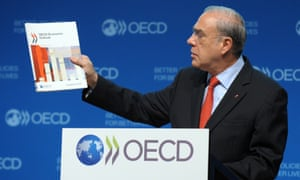 OECD Secretary General Angel Gurria presents the OECD Economic Outlook at the OECD headquarters in Paris on November 27, 2012.