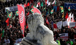 Protesters during a demonstration near the Portuguese Parliament, on the last day of discussion in Parliament of the draft State budget for 2013, in Lisbon, Portugal, 27 November 2012.