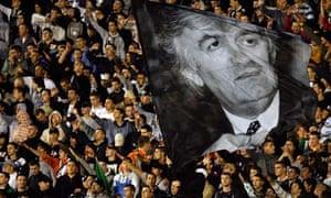 Partizan Belgrade fans wave a picture of Radovan Karadzic 23/7/08