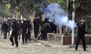 Riot police use tear gas during clashes with anti-Morsi protesters at Tahrir Square in Cairo on Tuesday.