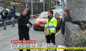 David Cameron visiting flood victims in Devon on 27 November 2012.