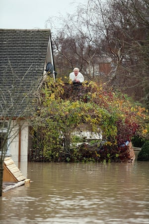 Residents rescued floods: A resident watches floodwaters