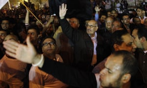 Egyptian opposition leader and Nobel Prize Laureate Mohammed el Baradei waves as he leads a march to join the tens of thousands in Tahir Square.