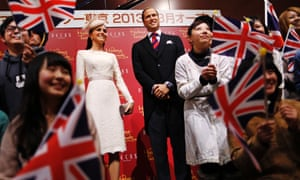 Life in plastic is fantastic: Fans wave Union Flags as they pose with wax figures of Prince William and the Duchess of Cambridge, at the opening of the Madame Tussauds in Tokyo, Japan.