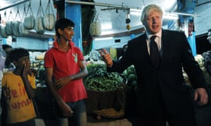 London Mayor Boris Johnson meets market stall holders in Hyderabad in central India, prior to a meeting with leading businessmen and women ahead of travelling to Mumbai.